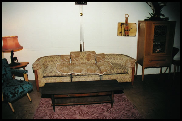The small piece of carpet on the floor in front of the sofa is a small section of the original carpet.