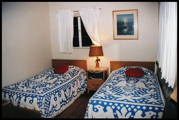The twin beds in Brother and Sister Branham's bedroom.