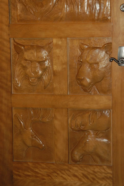 Door with animals carved in it